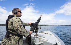 Master-at-Arms 1st Class Scott Ragsdale, mans an M240 machine gun aboard a rigid-hull inflatable boat during a harbor security training scenario at Pearl Harbor as part of exercise Citadel Protect in February. (U.S. Navy/MC2 Charles Oki)