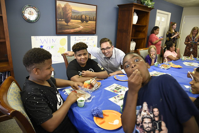 FNCS Acting Deputy Under Secretary Brandon Lipps enjoying a moment with kids during lunch service