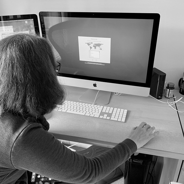 Setting up her new iMac