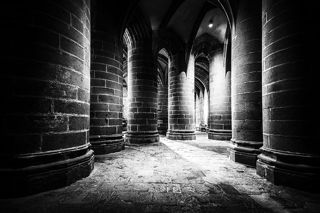in the crypte des gros piliers (crypt of the big pillars), Mont Saint Michel, Avranches, Manche, Normandie, France. Fine art black & white