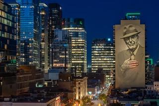Leonard Cohen mural by night