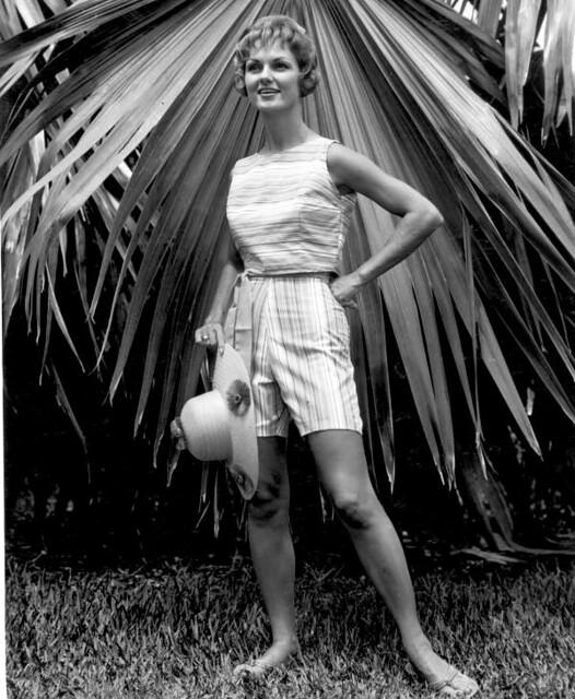 A fashion model in sportswear poses at Fairchild Tropical Garden - Miami