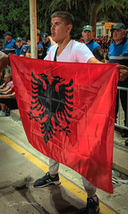 Young Man Proudly Displaying the Albanian Flag