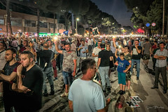 On Cue Protesters Turn on their Mobile Phone Lights