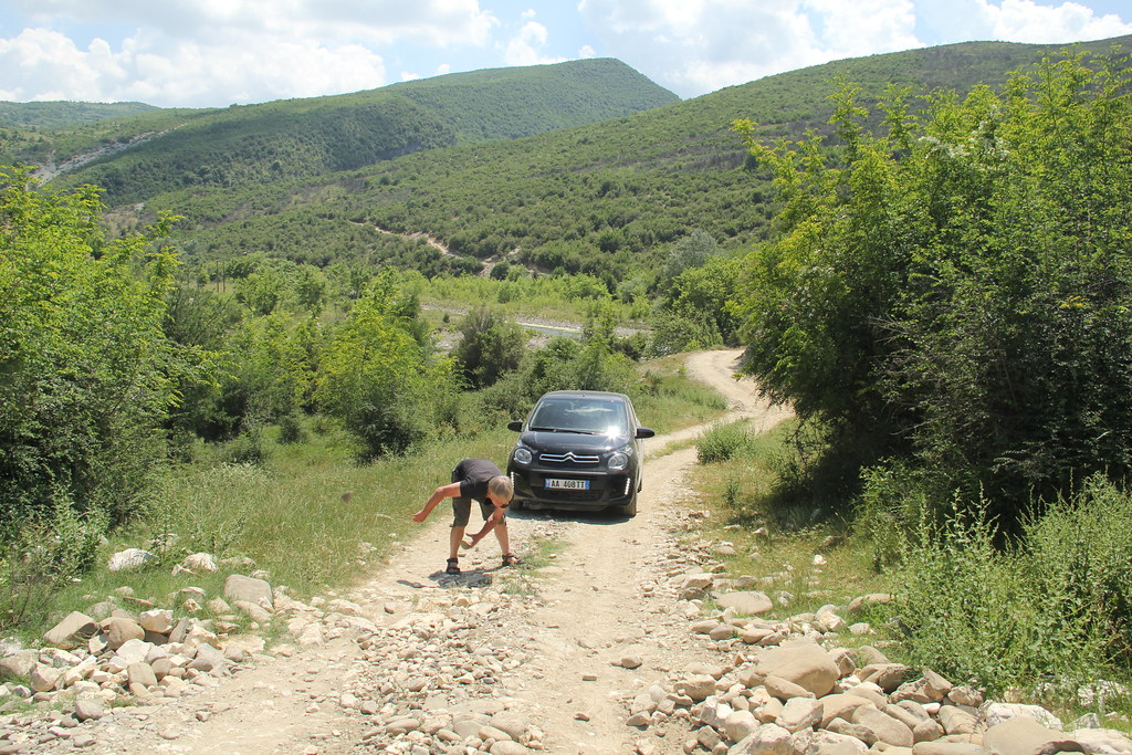 Stu removing the rocks from one particularly bad part of Albania's 'highways'