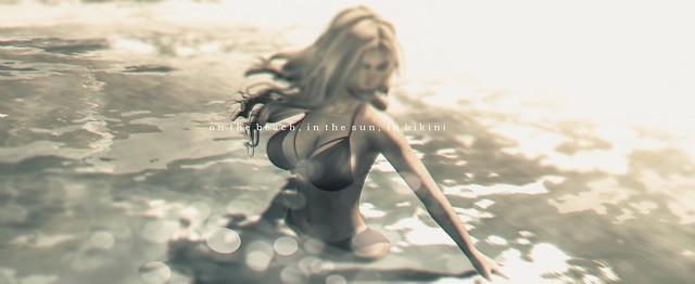 On the beach, in the sun, in bikini
