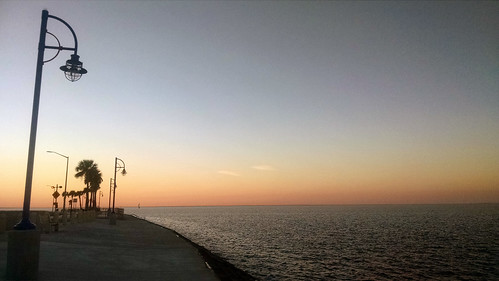 lakepontchartrain pontchartrain neworleansla louisiana neworleans lampost streetlight lake sunset sky