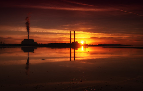 sunrise dublin bay poolbeg powerstation incinerator sewage water beach sky