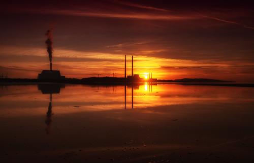 sunrise dublin bay poolbeg powerstation incinerator sewage water beach sky