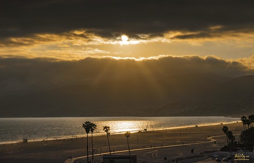 sunset light clouds rays sky beach california santa monica
