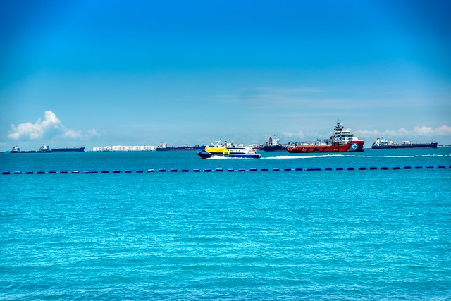 Batam ferry and ships in the roadstead in Singapore