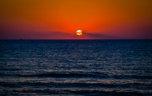 satellitebeach florida unitedstatesofamerica sunrise over atlantic ocean satellite beach fl us usa america space coast water coastline sun orange yellow dawn morning