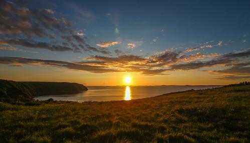 andygocher canon100d europe uk wales southwales westwales sun sunset sunshine clouds skyscape reflection water sea seascape landscape stbridesbay pembrokeshire coastalpath littlehaven