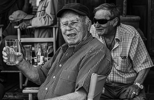 Cheers - Local Man (Cafe Aigaion - Myrina Town   Lemnos - Limnos) (Mononchrome)  (Panasonic S1 & S Lumix 24-105mm F4 Zoom) (1 of 1)