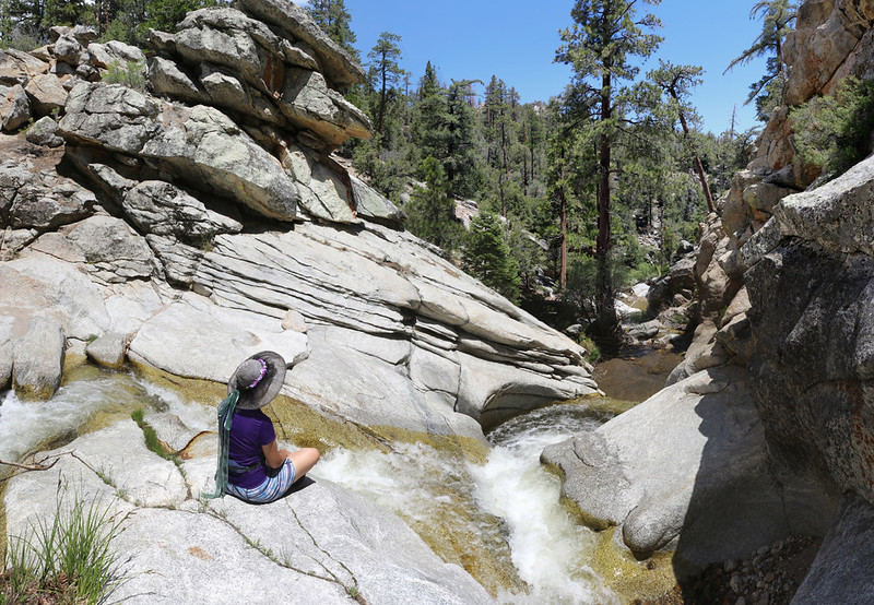 Vicki enjoying the sound of Tahquitz Creek as it races down the granite into a pool at Caramba Camp