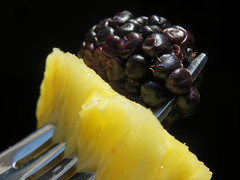 Pineapple And Blackberry On A Fork