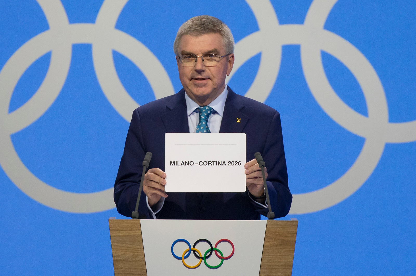 IOC President Thomas Bach announces Delegates from Milan - Cortina win the 2026 Winter Olympics during the first day of the 134th IOC Session at Swisstech