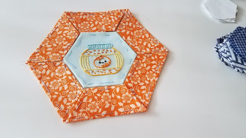 Half hexagons and embroidery
