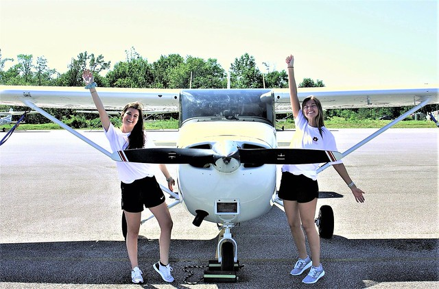 Caitlyn Miller and Kendall Higdon with their plane before the Air Race Classic.