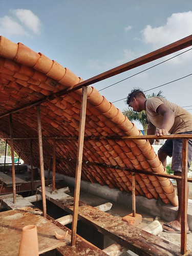 terracotta roof orange vault sustainable architecture tube guna bilaspur india building rootedkite