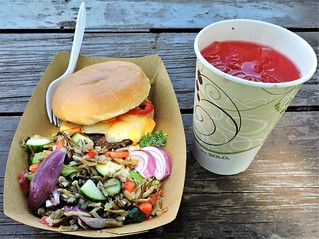 Bison cheese burger with onions and hot peppers; wild rice salad; strawberry drink