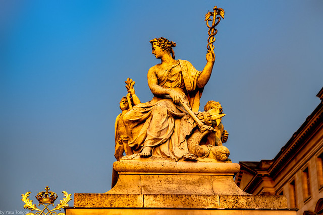 Early sunrise highlighting statue at Golden Front Entrance to Palace of Versailles France-16a