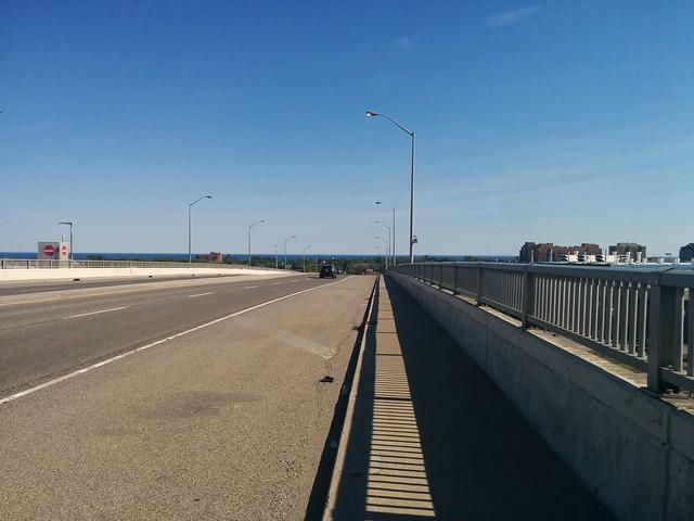 Looking south down the Islington Avenue Bridge #toronto #etobicoke #islingtonave #islingtonavenuebridge #skyline #lakeontario #blue #latergram