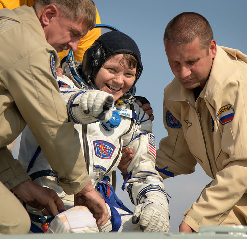 NASA astronaut Anne McClain is helped out of the Soyuz MS-11 spacecraft | by NASA Johnson