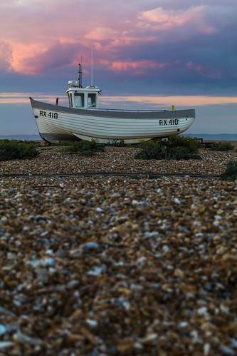 dungeness kent england uk fishingboat beach sunset shallowdepthoffield shallowdof pink clouds pebbles canon 80d 70200mmf4lis