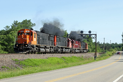 """The End Is Near! Everybody showed up on a perfect Saturday to watch the crew of OL-3 put on a smoke show as its quartet of big 6 axle MLW's pass under the old Position Light signals at """"North Eldred""""."""