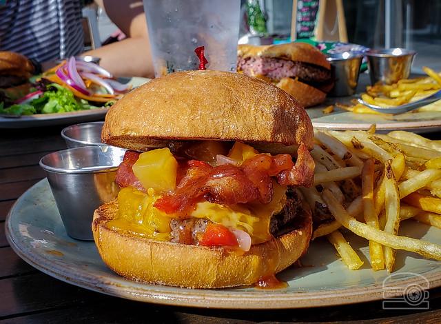 Burger w/ pineapple mango chutney, cheddar, bacon, and BBQ sauce - Table 9
