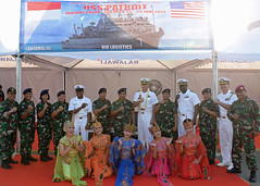 USS Patriot (MCM 7) leadership pose for a photo with their welcoming party in Jakarta, June 25. (U.S. Embassy Jakarta)