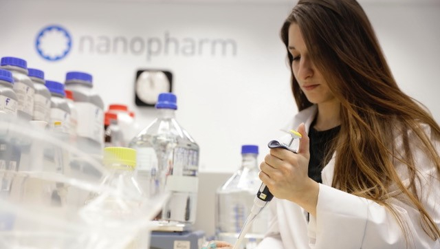 A shot of a scientist in the Nanopharm lab