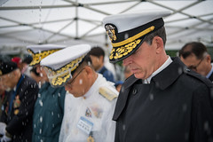 "Rear Adm. ""Buzz Donnelly bows his head for a moment of silence during a ceremony commemorating the 69th anniversary of the Battle of Daehan Strait, which marked the start of the Korean War. (U.S. Navy/MC2 William Carlisle)"