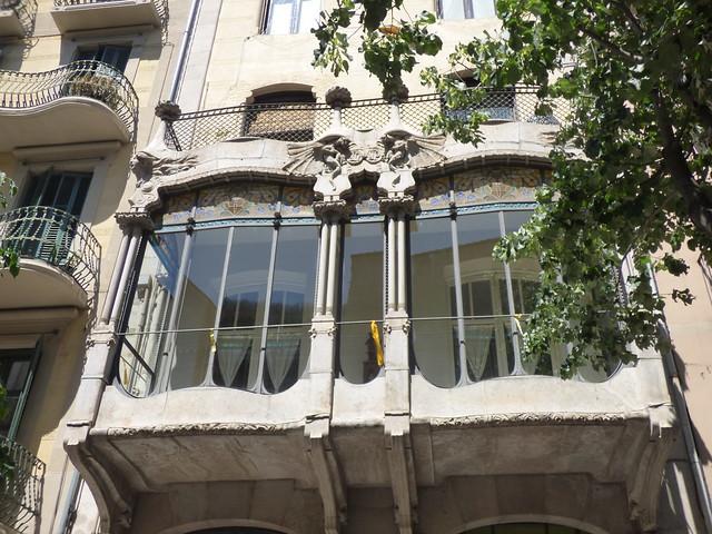 Rambla de la Llibertat, Girona - windows and sculptures near apartments