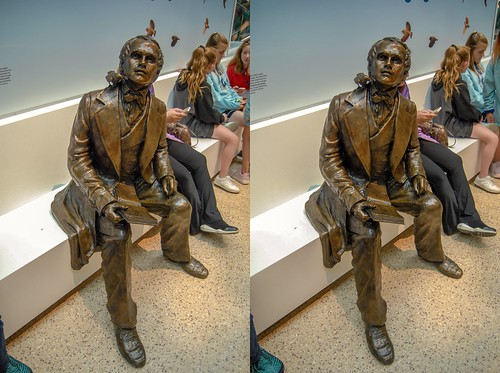 Sculpture of a seated Charles Darwin at the Smithsonian Museum of Natural History's FossiLab.