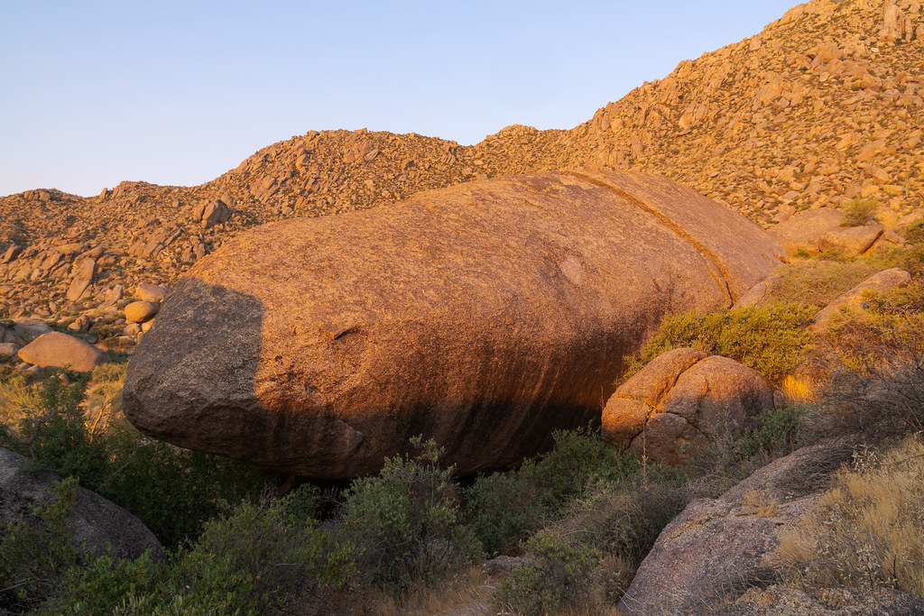 Submarine Rock is bathed in soft red light early on a spring morning on the Marcus Landslide Trail in McDowell Sonoran Preserve in Scottsdale, Arizona in June 2019