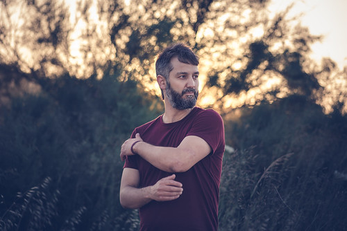portrait people man samos blur bokeh remembrance sky sunset sun light summer outside art old red magenta yellow orange green blue plants
