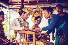 BALI, INDONESIA - APRIL 13, 2018: Newlyweds on balinese wedding ceremony. Traditional wedding.