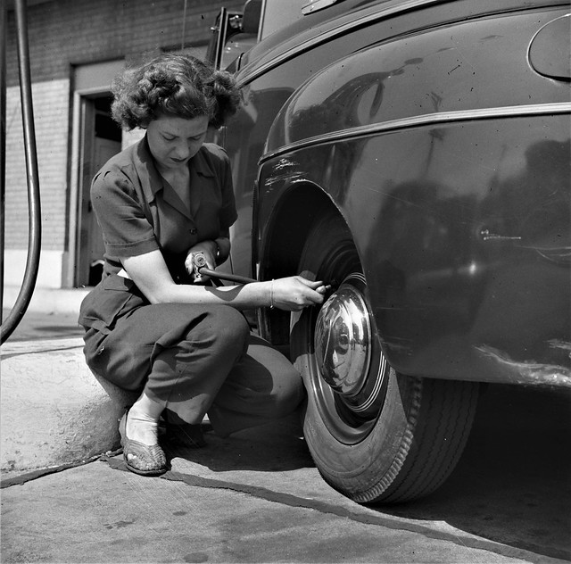 Michellin Woman: Ms. Virginia Lively used to be a beauty operator. Today she works at a gas station -an example of how women are taking over jobs in wartime once occupied by men who are now in the service. Louisville, Kentucky. June 1943.
