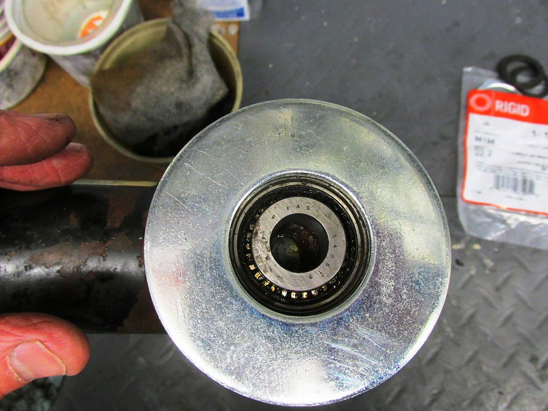 Washer Rests On Edge Of Tube That Holds The Bearing