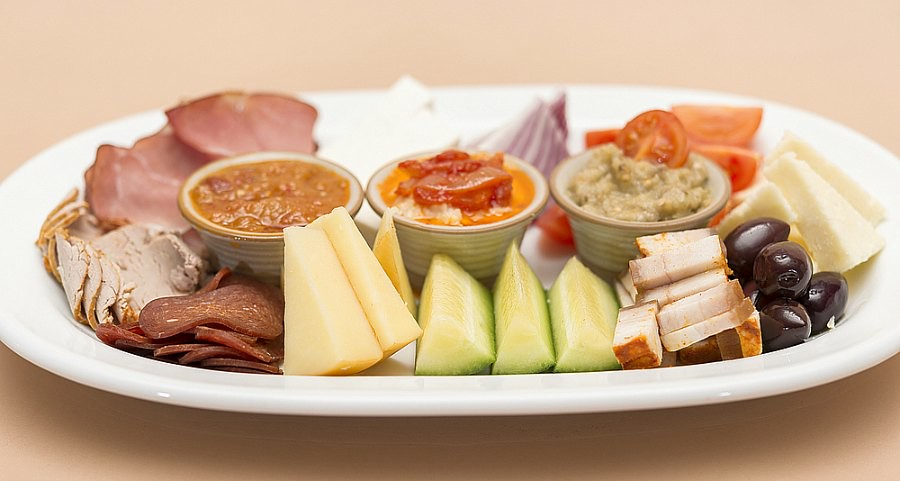 Romanian Dishes: Mezeluri platter with meat, cheese and spreads
