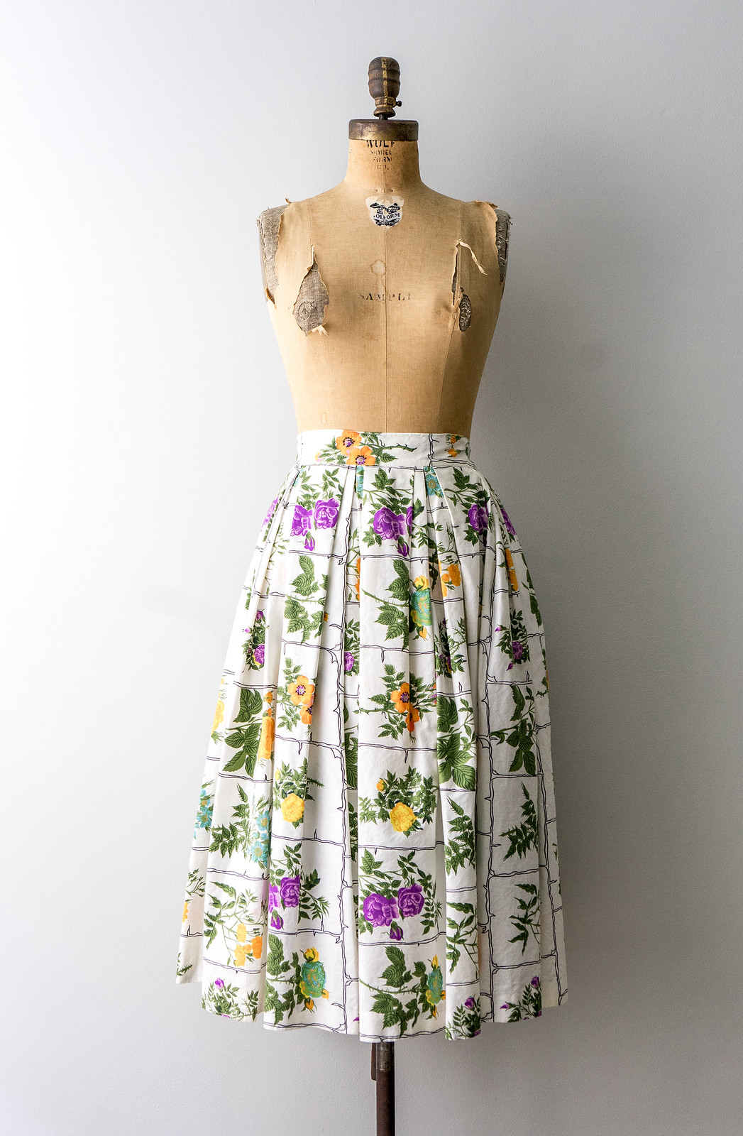 white and colorful floral pleated skirt