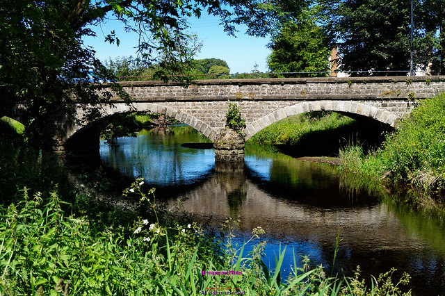 Bridge reflection over the Braid river in Broughshane