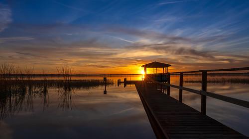 auburndale florida unitedstatesofamerica sunset water reflections lake dock