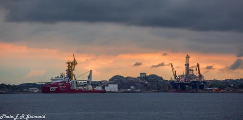 hanøytangen hordaland vestland hjeltefjorden norway sunset fjord oilrig supplyship silhouettes dark waterscape cloudscape heaven clouds landscape nature canon getty