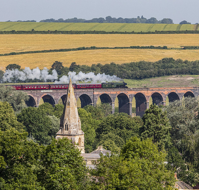 St John the Baptist church spire and flying Scotsman