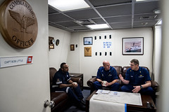 Josaia Maiwai, left, a Fijian fisheries officer, meets with Capt. Bob Little, center, commanding officer of USCGC Stratton (WMSL 752), and Lt. Cmdr. Eric Quigley, the ship's operations officer, while underway in the Western Pacific, June 25.  (U.S. Coast Guard/PO2 Jasmine Mieszala)