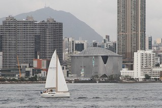 Sailboat heads through Victoria Harbour | by Marcus Wong from Geelong