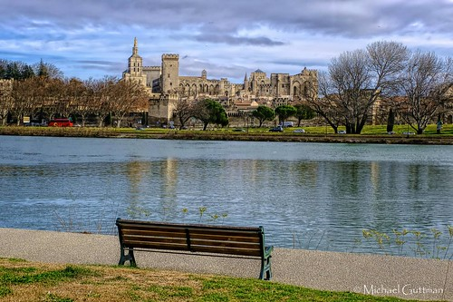 avignon france palaisdespapes palaceofthepopes rhoneriver bench river water waterway palace citywalls 14thcentury park sky clouds trees